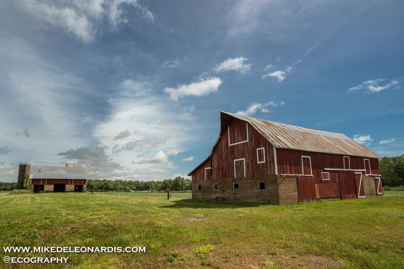 This barn was situated in the middle of nowhere in Kansas. I loved the curved roof it had and it was angled perfectly with respect to the more distant barn.