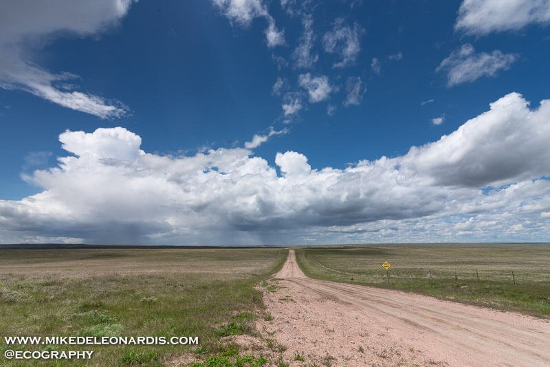 This photo may not be a photo that hangs on someones wall, but it shows the vast emptiness of Wyoming. In an area of Wyoming where dirt roads are the way of life this lone road went on for miles and miles. At the end of this endless road was a nice thunderstorm.