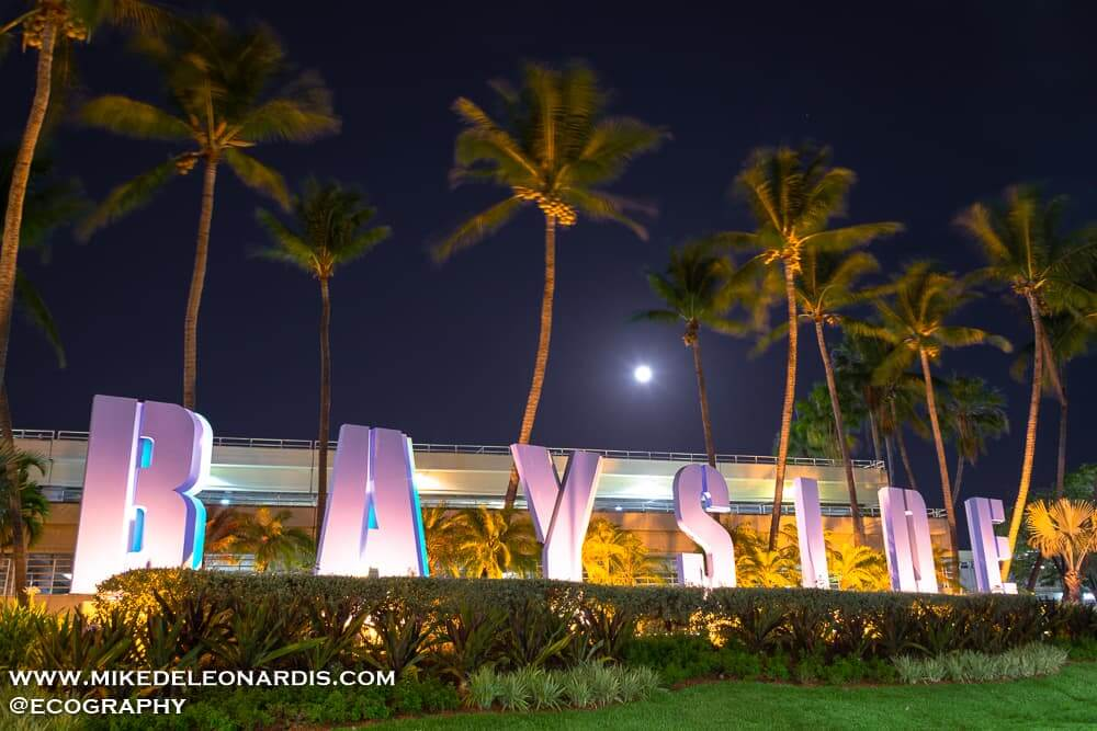 Full Moon rising over Bayside Marketplace in Miami, FL. Bayside is a major tourist attraction in Miami with tons of restaurants, shopping, boat tours, and live performances.