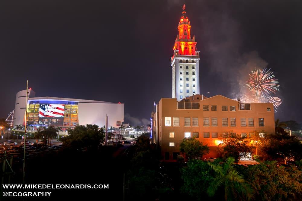 4th of July fireworks over Miami, FL with the Freedom Tower and the American Airlines Arena in the foreground.
