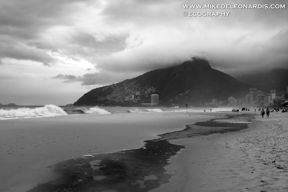 A storm was rolling over Copacabana beach in Rio de Janeiro. Fortunately most people weren't on the beach due to the storm allowing me to get a shot of a mostly deserted beach.