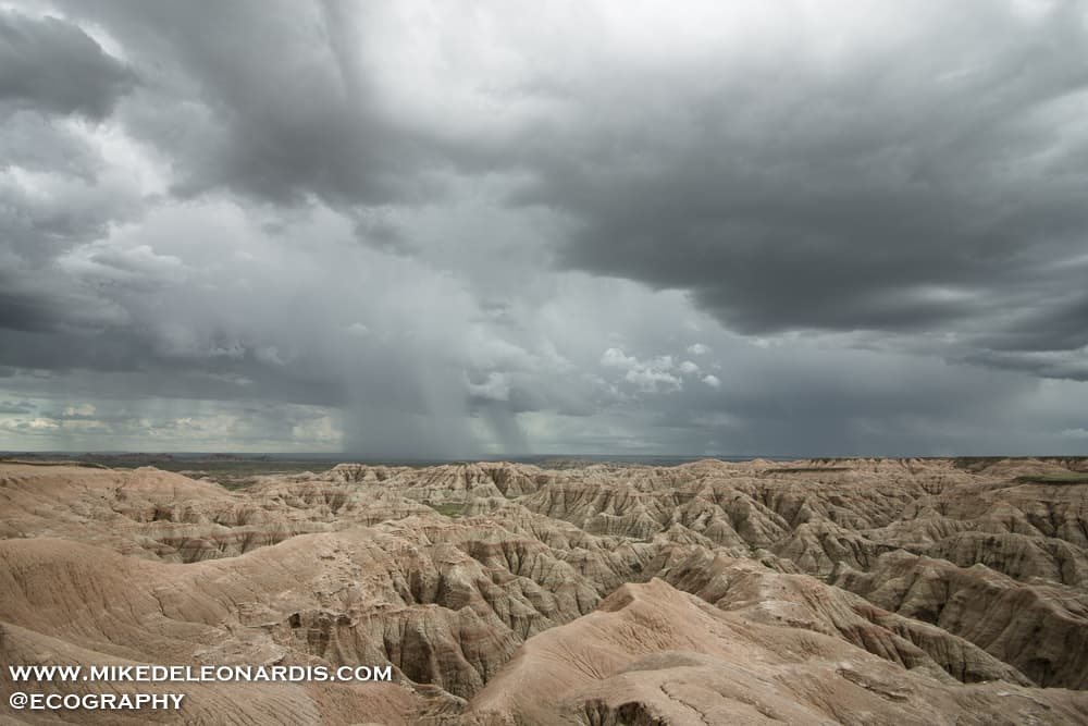 A spring storm rolling across the Badlands of South Dakota. The storms this day produced quarter-inch hail and 50mph winds. This area used to be under a body of water called the Western Interior Seaway until about 60 million years ago. As volcanic ash settled to the bottom of the ocean it hardened and created these vast landscapes.