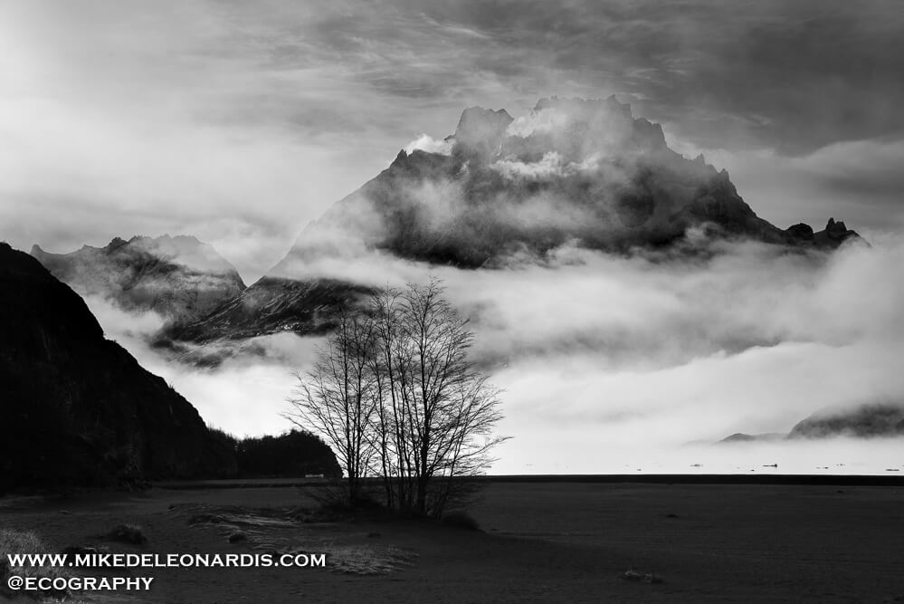 The whole day was foggy, snowing, and with low visibility. As I was leaving the area I happened to turn around and see the clouds clearing just enough for this picture. The clouds were so thick beforehand that I had no idea this huge mountain was hiding behind the clouds.
