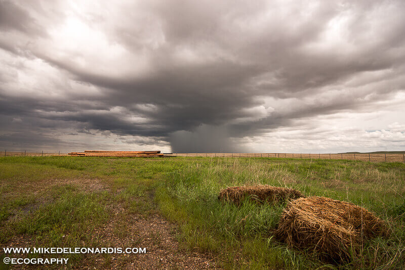 I didn't plan on it, but I ended up storm chasing in the Badlands of South Dakota this day. I knew there wouldn't be any tornadoes there but I was pleasantly surprised by the number of hail producing storms. This storm, along with many other storms, produced pea sized hail. This picture was taken just outside of the park boundary.  I drove on a dirt road for a bit to get closer to the storm until I couldn't easily drive towards it anymore.